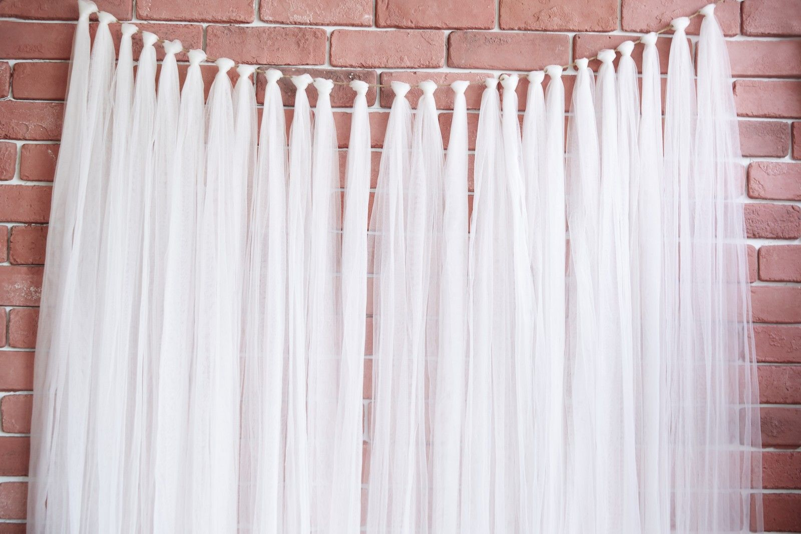 Tulle strip garland backdrop merrylove weddings for Wedding backdrops
