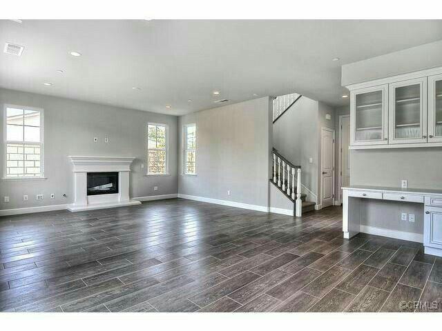 grey wood floor colors. big and open  tile wood floor BUILT IN DESK right in living room love it LOVE the grey floors I colors of walls flooring made to look