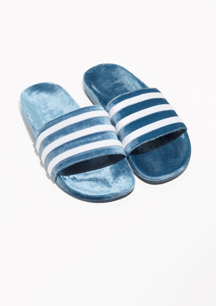 sports shoes 7b0d0 9721d Other Stories image 2 of adidas Adilette Slides in Blue