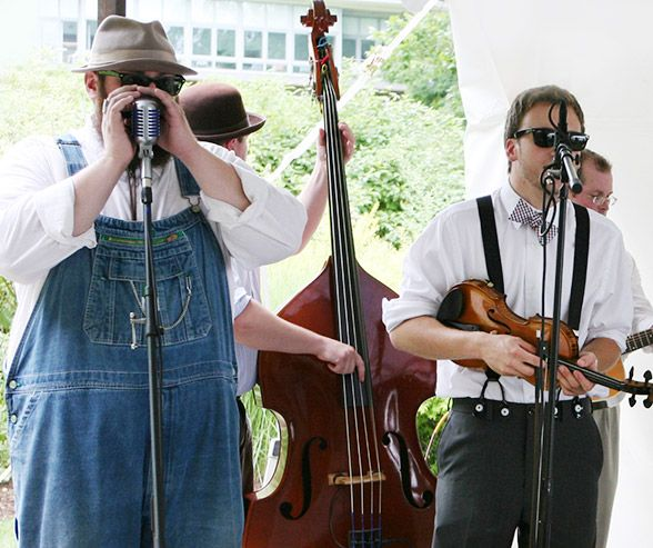 A live band decked out in overalls, suspenders and bow ties entertains guests during the reception.