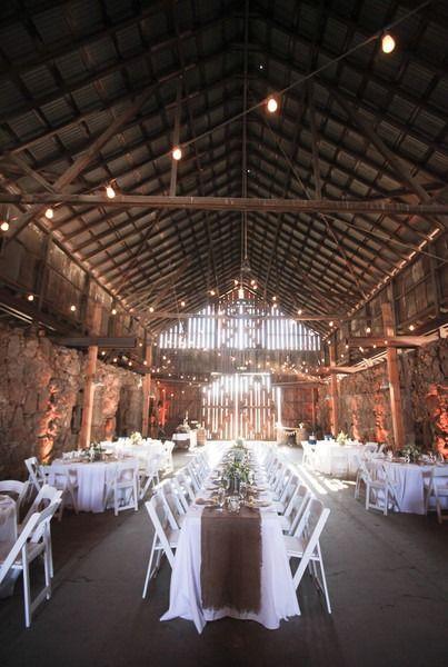 Rustic wedding reception decor idea - barn venue with white table linens + burlap table runners {The Historic Santa Margarita Ranch}