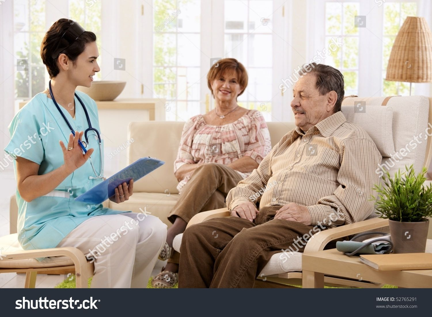Nurse Talking With Elderly People And Making Notes During Examination At Home Smiling Ad Sponsored Elderly In 2020 Home Health Aide Healthcare Jobs Home Health