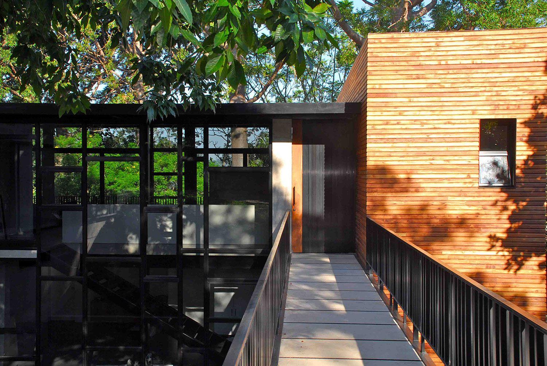 black iron railings bridge modern house design with glass window