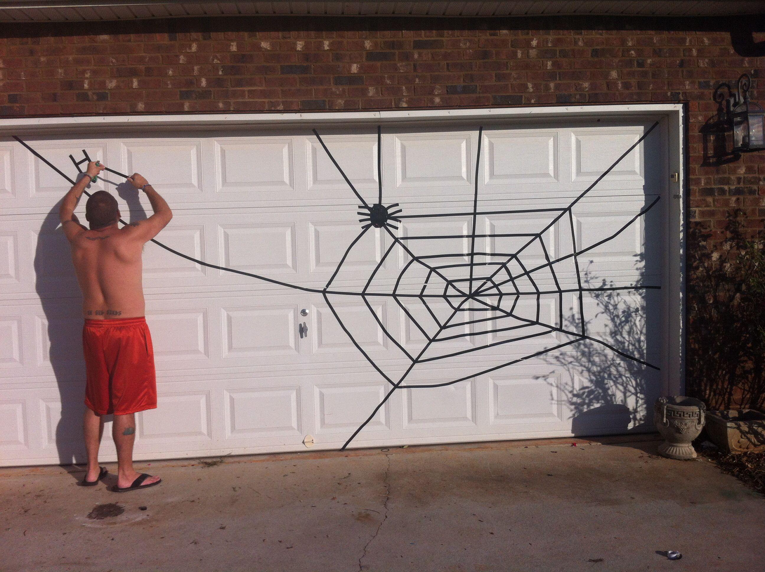 Diy halloween garage door decorations - Spider Web For Halloween Garage Door Use Electrical Tape