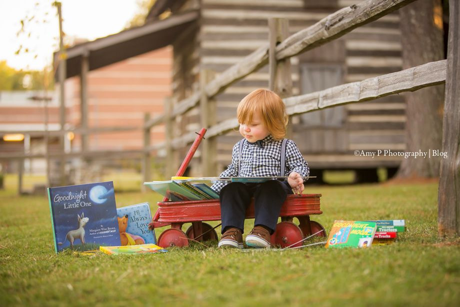I love all the book props that were added on during this outdoor family photo session!!! The red wagon and everything was perfect!