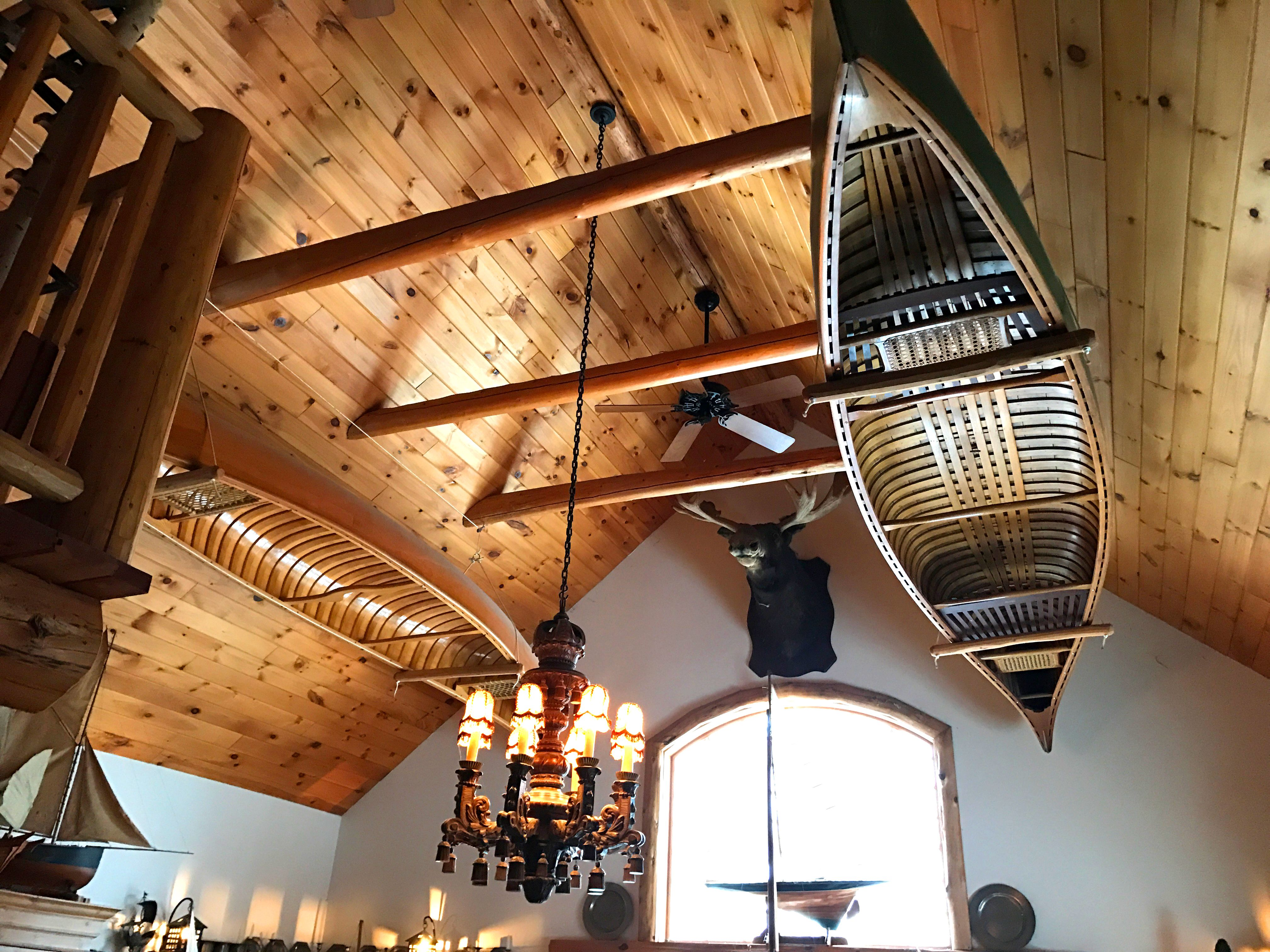 Our Great Hall With A Of Hanging Vintage Wood Canoes