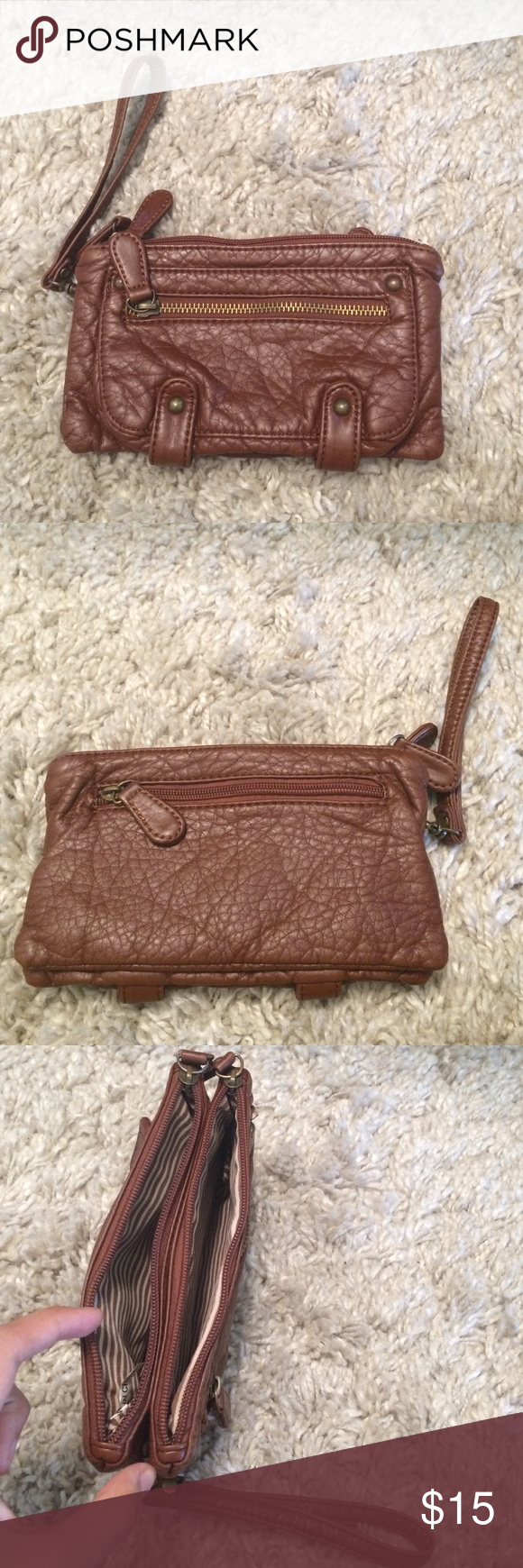 Wristlet Brown wristlet. 4 pockets. No flaws. Bags Clutches & Wristlets