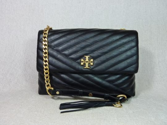 3e1f7ee2682 Tory Burch Kira Chevron Black Leather Shoulder Bag. Get one of the hottest  styles of the season! The Tory Burch Kira Chevron Black Leather Shoulder Bag  is a ...