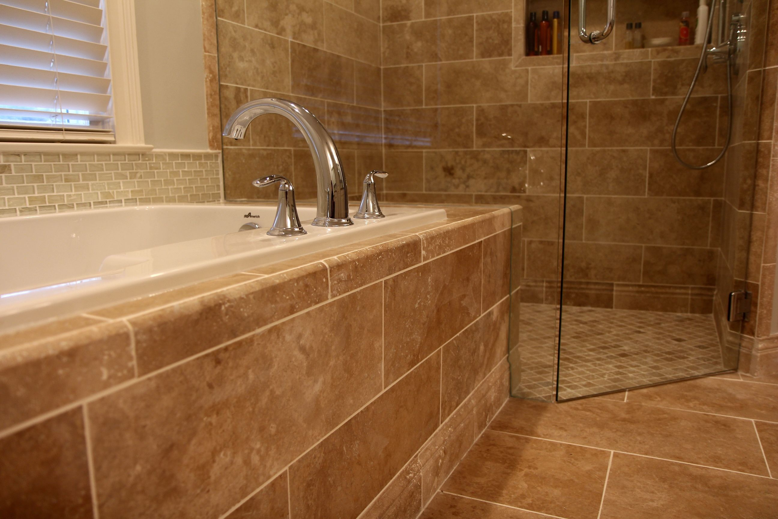 View of tub with light walnut travertine tile from thetileshop view of tub with light walnut travertine tile from thetileshop ppazfo