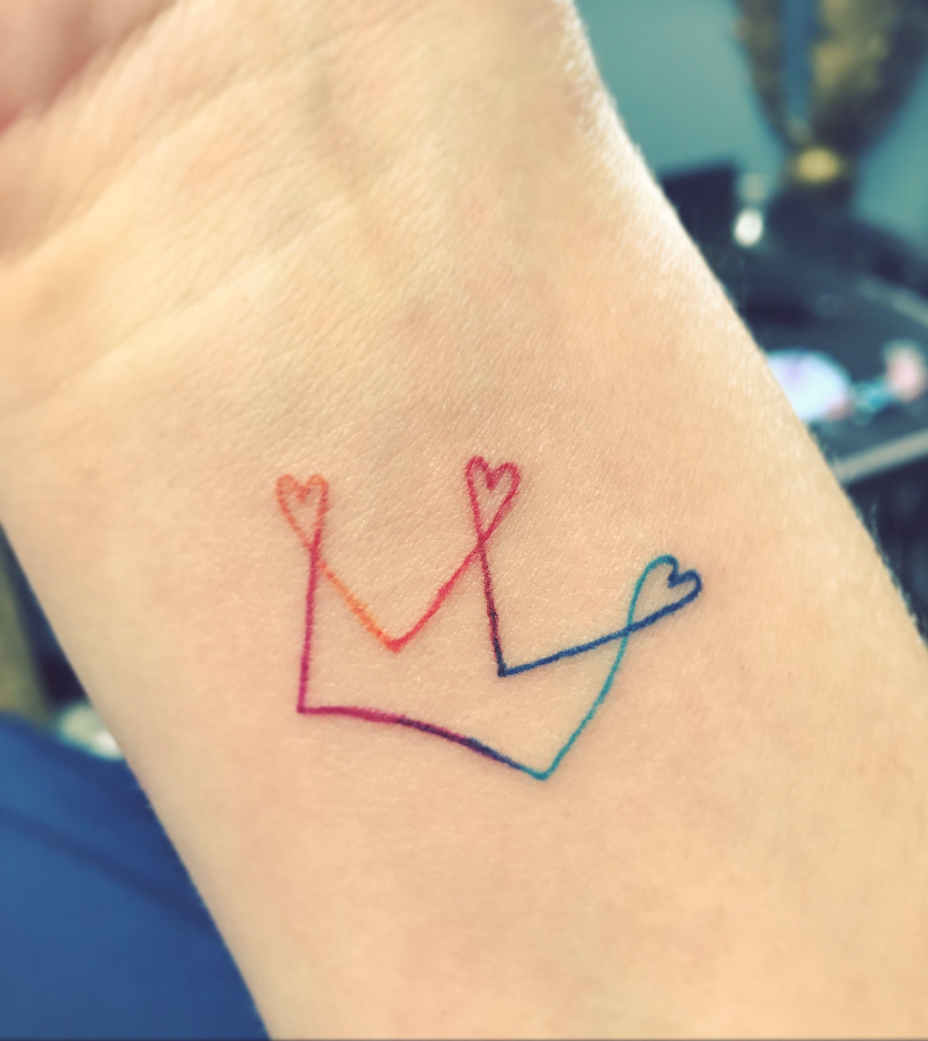 Rainbow crown tattoo, multi color tattoo, small tattoo