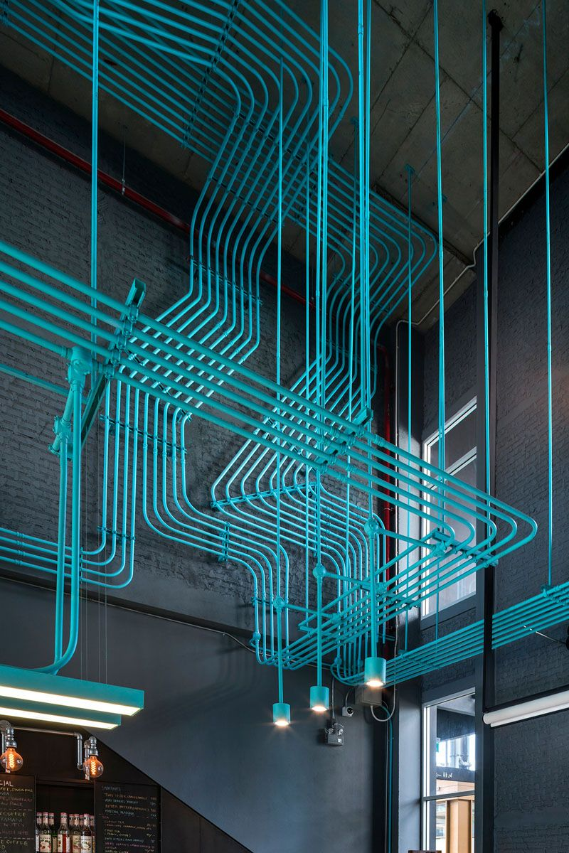 Turquoise electrical conduit is a design feature running through ...