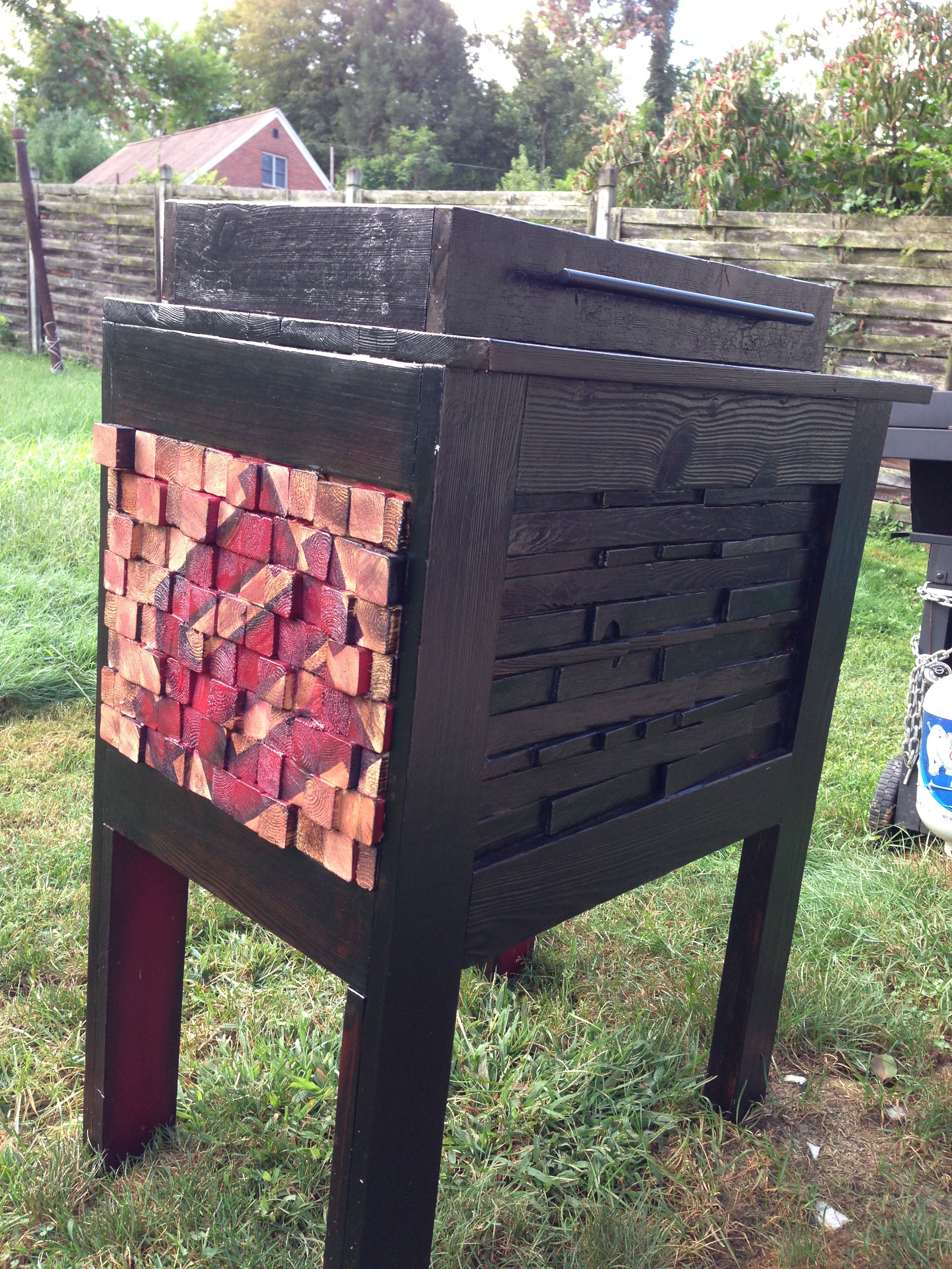 Cooler stand- Cedar burnt shou-sugi-ban style. Coated with outdoor polyurethane. Cedar shims on the front done the same way. 2x2s on the sides cut to different lengths. Of course I had to put an IU on there. Go Hoosiers!