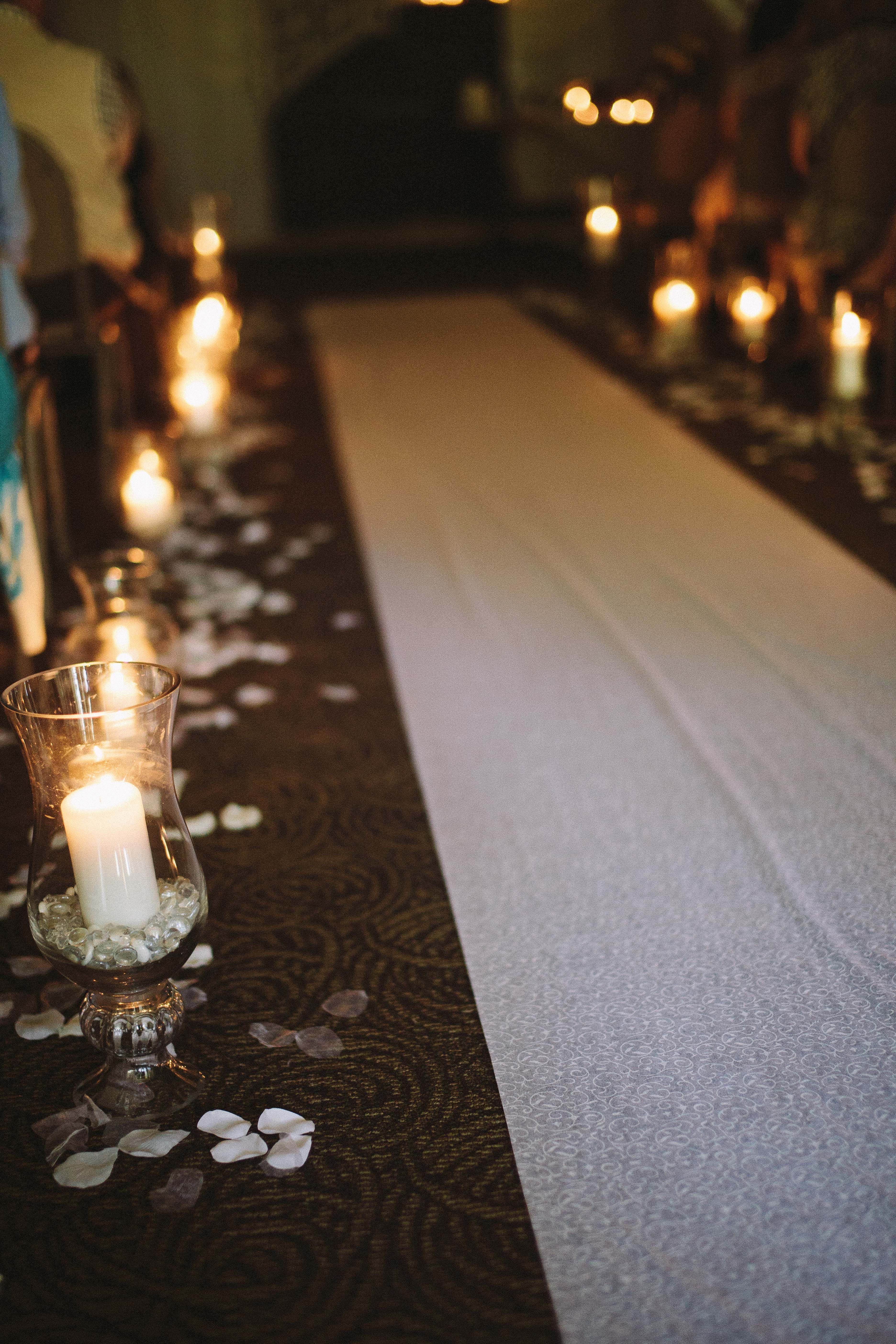 Candles And Petals Lining The Aisle Way
