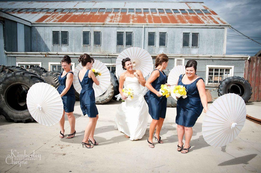 My friend Jess's wedding. Outside with sun umbrellas kinda cool