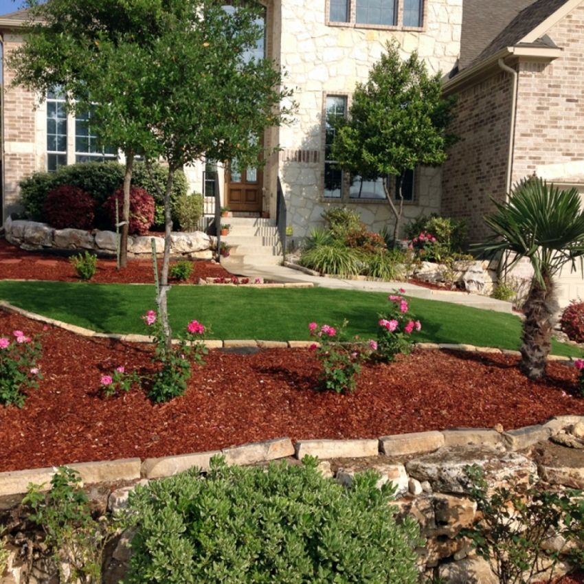 Landscaping Ideas For Sloped Front Yard: Beautiful Front Yard Landscape With Red Mulch, Roses And