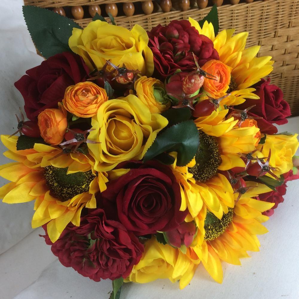 - a brides wedding bouquet featuring artificial silk roses ...