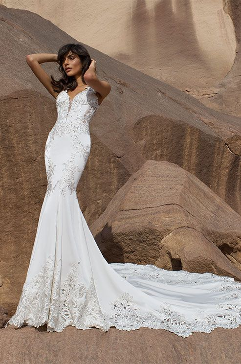 An off white crepe satin fit-and-flare with Guipure embroidered lace with illusion back with pearls and rhinestones and illusion straps. Pnina Tornai 2016 Wedding Dress Collection