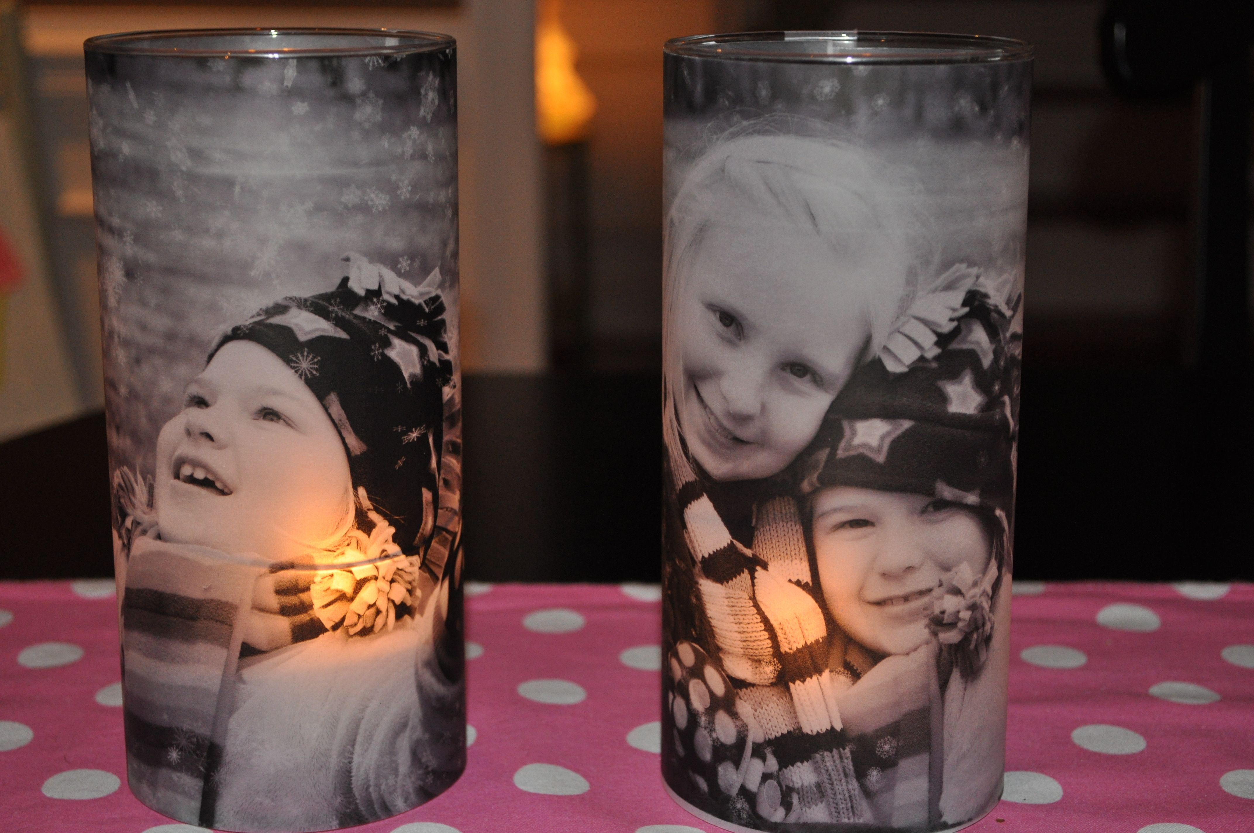Votive candle holders made with vases, and printed vellum pictures, wrapped around outside of vase.  Printed pictures on Vellum from Michael's, let ink dry, then cut to size.  I used double sided tape to secure to vase.