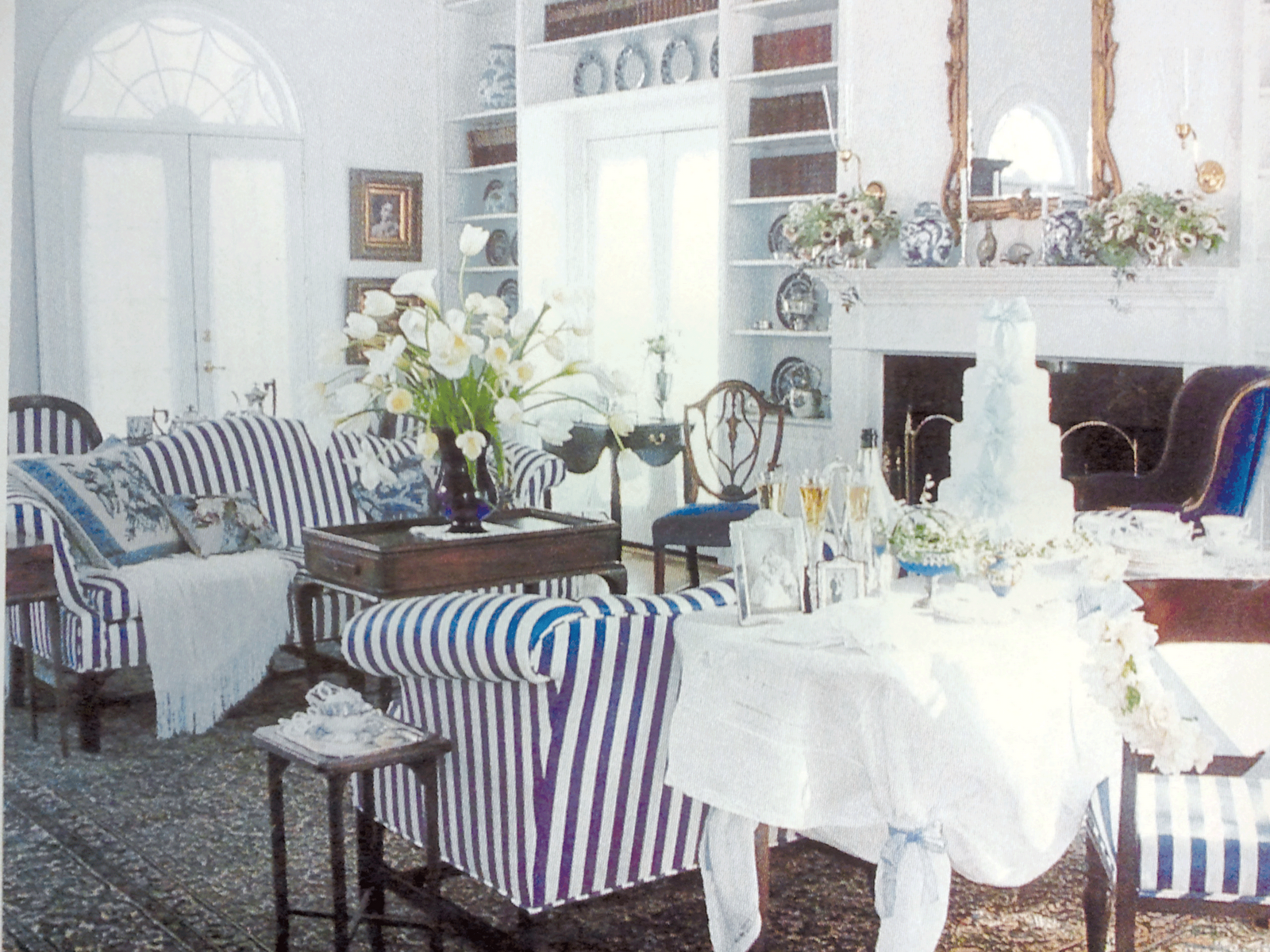 A traditional living room with navy & white striped sofas ...