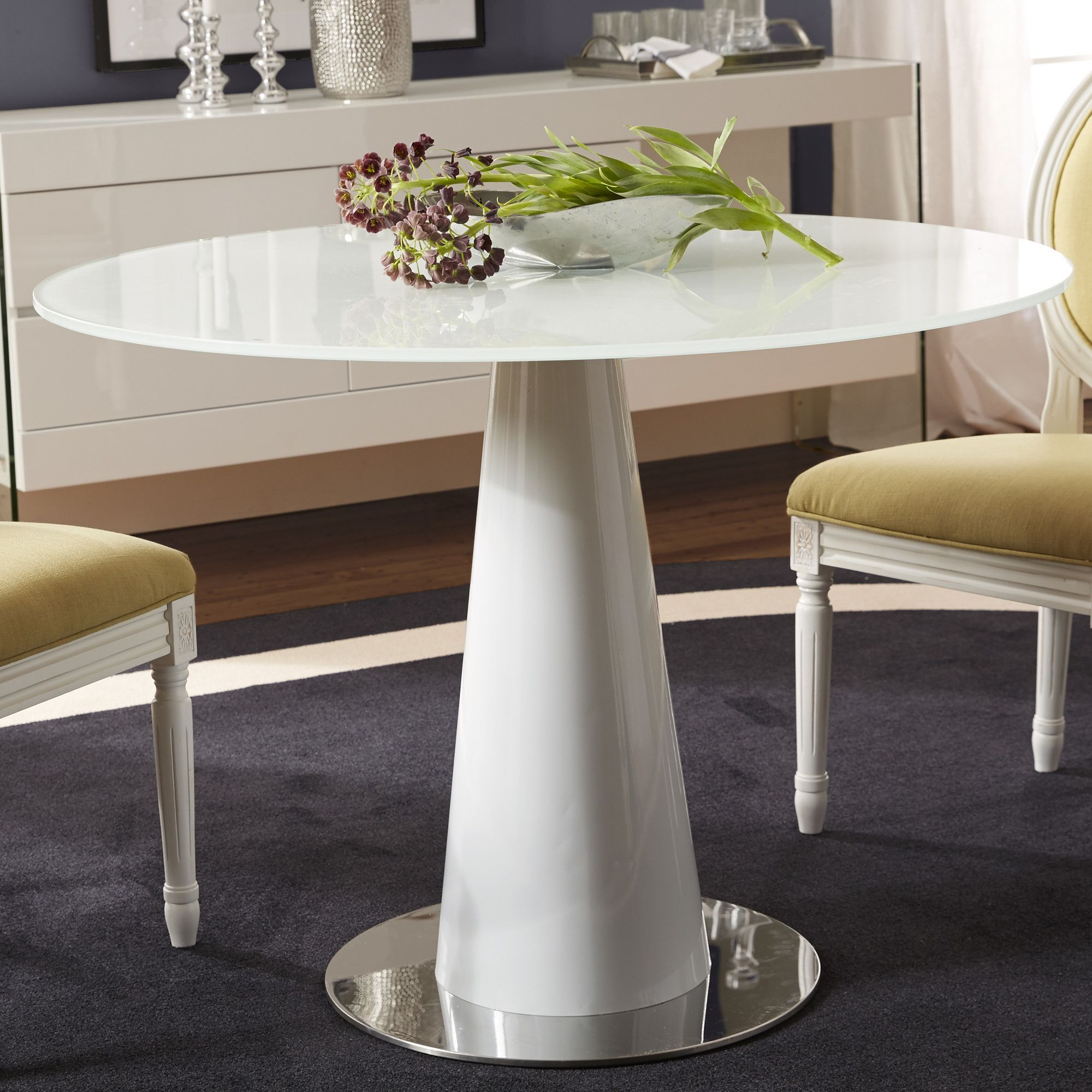Captivating Anchor A Contemporary Dining Ensemble With This Minimalist Table, Featuring  A White Lacquer Finish And Pedestal Base.