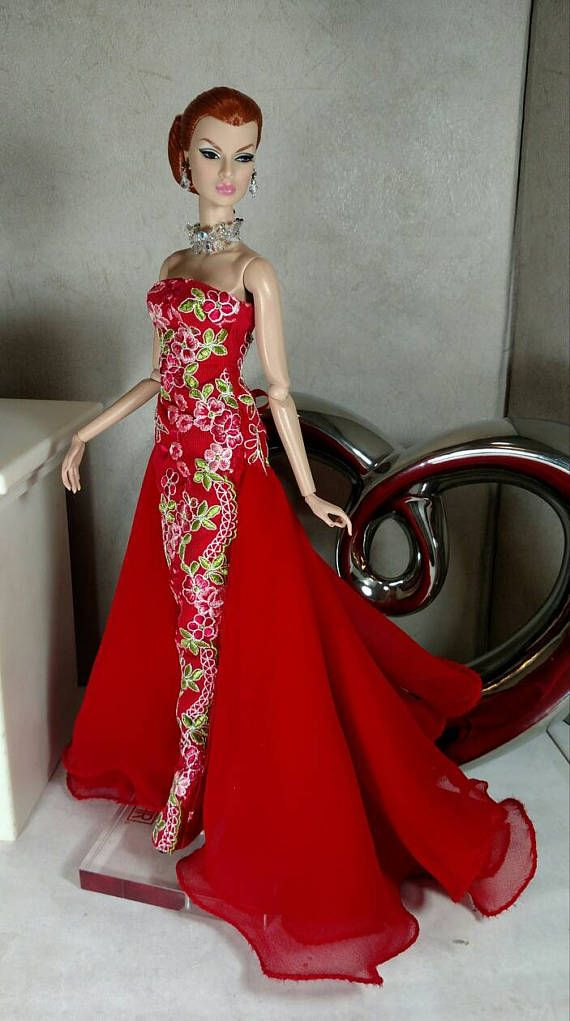 This sheath gown is made from red silk dupioni and a red embroidered tulle overlay. Red silk chiffon train and line in white silk. Corset closure for a snug fit. This gown will fit Silkstone Barbie and Poppy Parker but the gown may be a little long. From a smoke and pet free home.