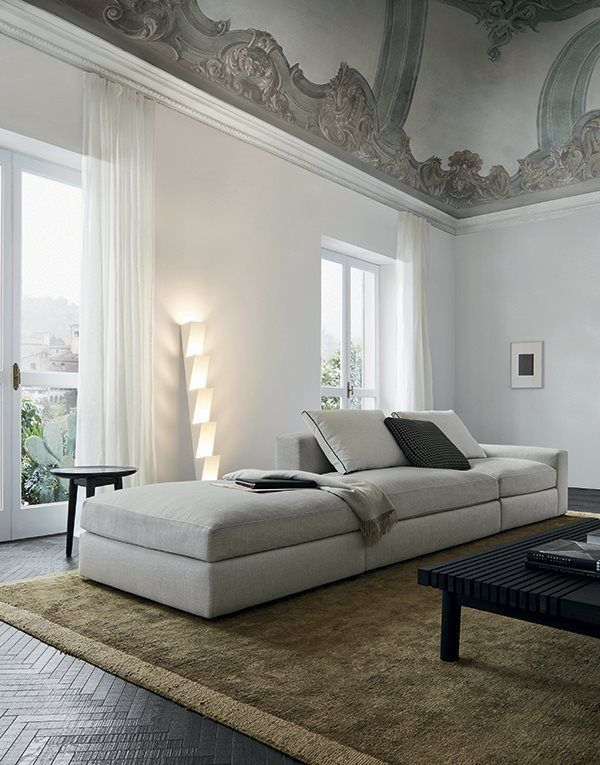 sofa and pouf Dune in removable fabric Caledonia 5 bianco, Home Hotel Collection coffee table in black elm, Mad coffee table with structure in black elm and top in mat petit granit Marble.