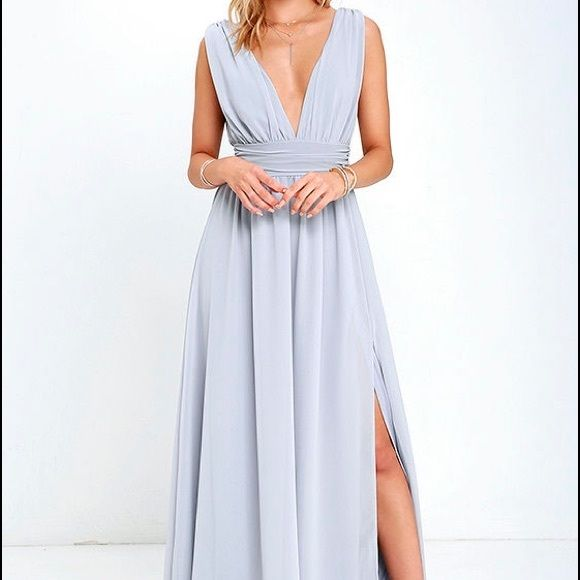 Gorgeous Light grey maxi dress. New with tags. Sold out online! Size medium. Fabric that drapes alongside a v-neck and back, lays across a banded waist. Full maxi with a slit. Hidden back zipper with a clasp. Lulu's Dresses Wedding