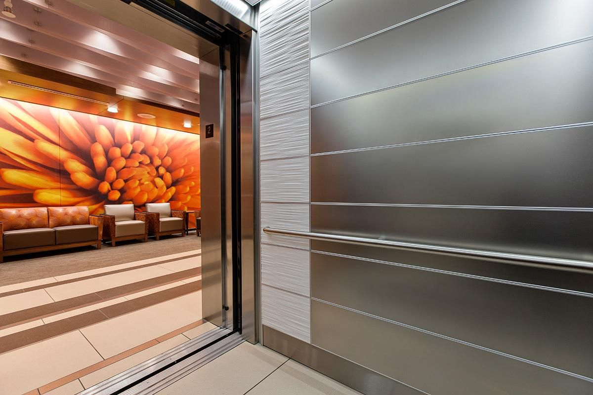 levele-103 elevator interior with panels in stainless steel with