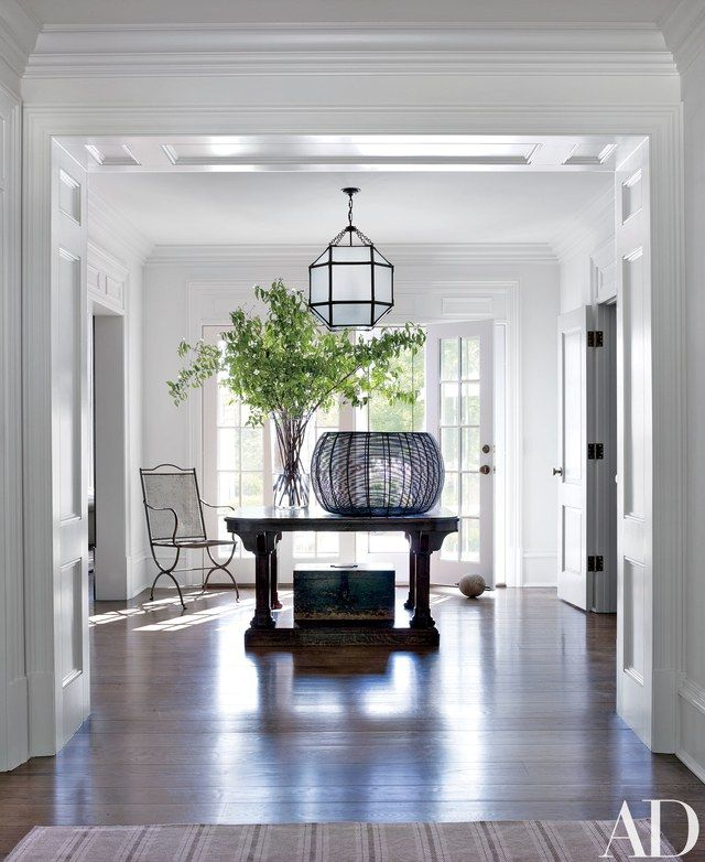 In The Entrance Hall, A Lantern By Suzanne Kasler From Circa Lighting Hangs  Above The