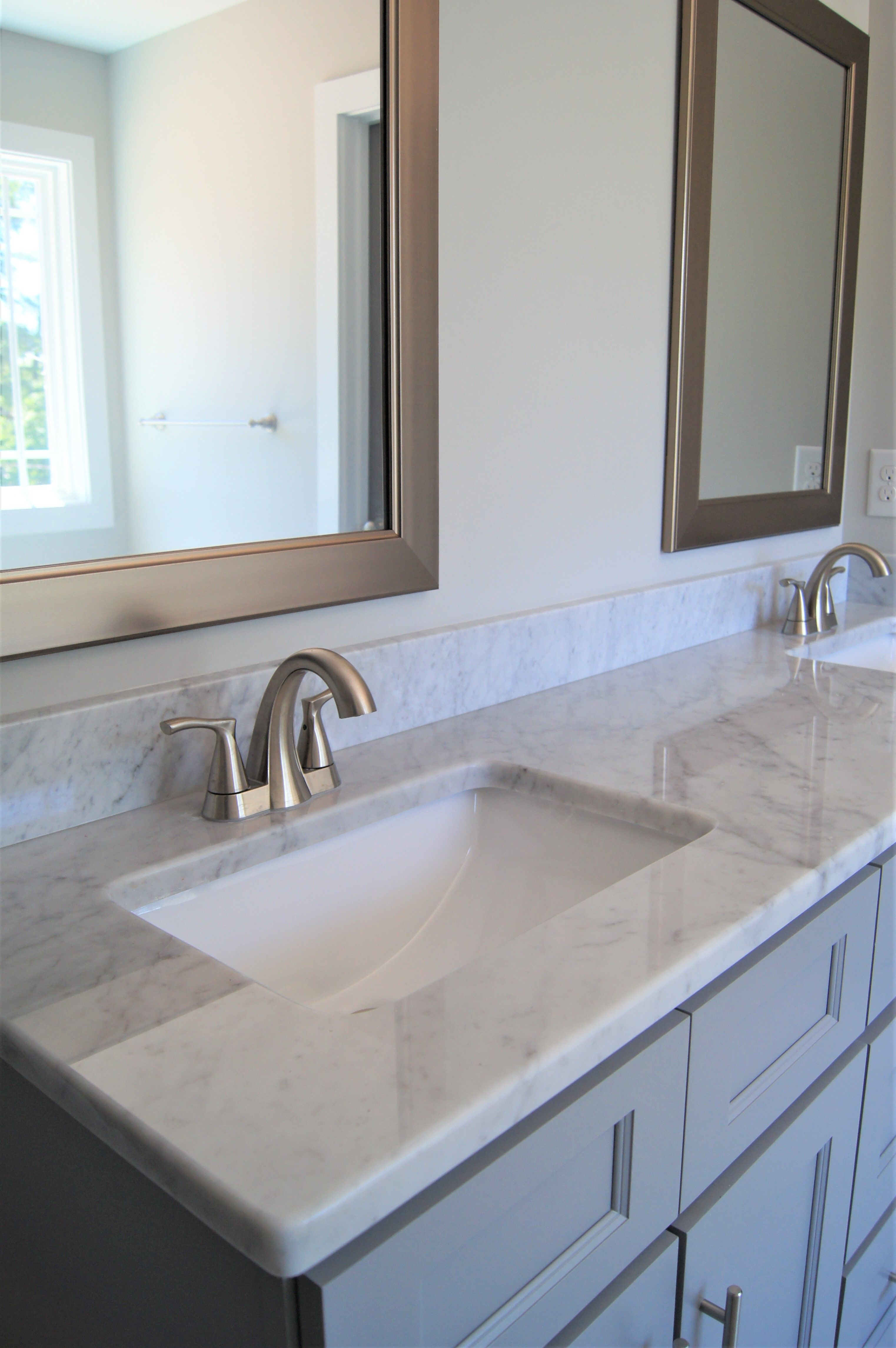 Gray Cabinets And White Natural Stone Counter Tops Are The Latest