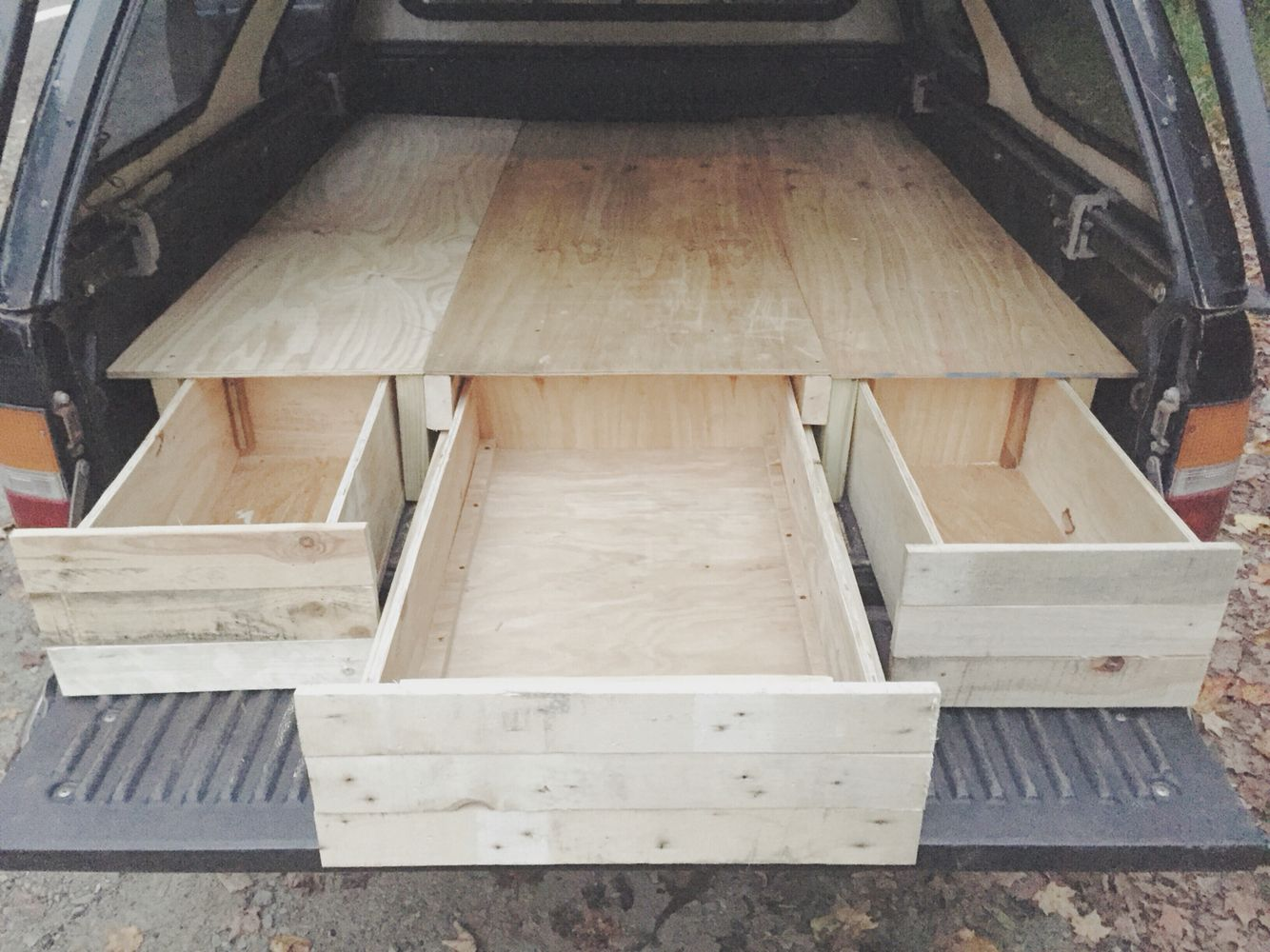 truck bed camper with drawers made completely from reclaimed wood and screws