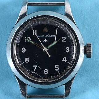 Lot 371 - A Jaeger Le Coutre military wrist watch. Sold at auction on Thursday 18th May for £5,200