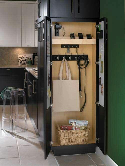 Small Storage Side Cabinet Next To Refrigerator In Kitchen