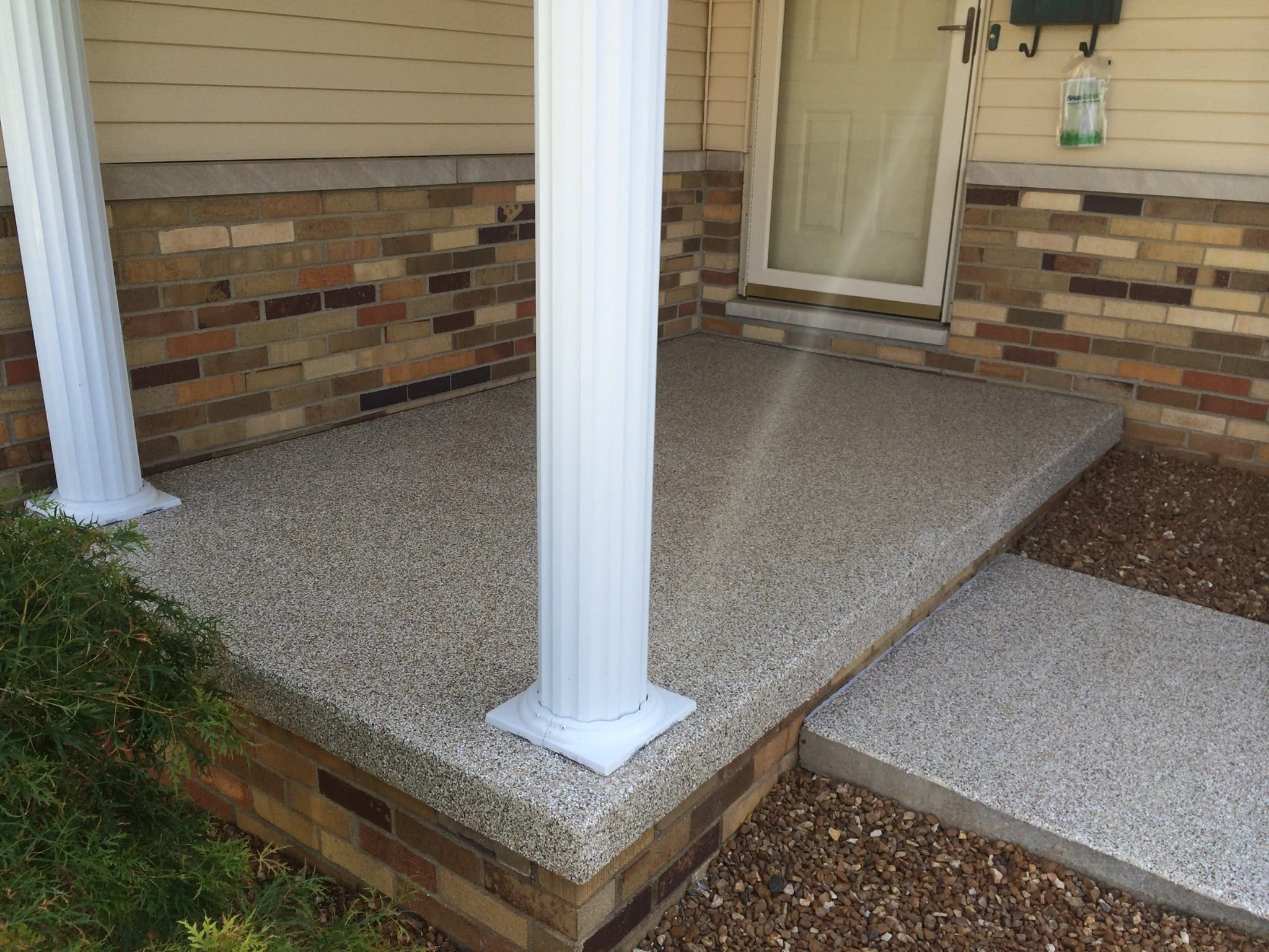 Decorative concrete front porch resurfacing normal il illinois decorative concrete contractors Exterior concrete floor coatings
