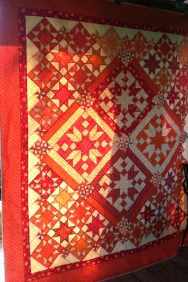 Beautiful orange monochromatic quilt.