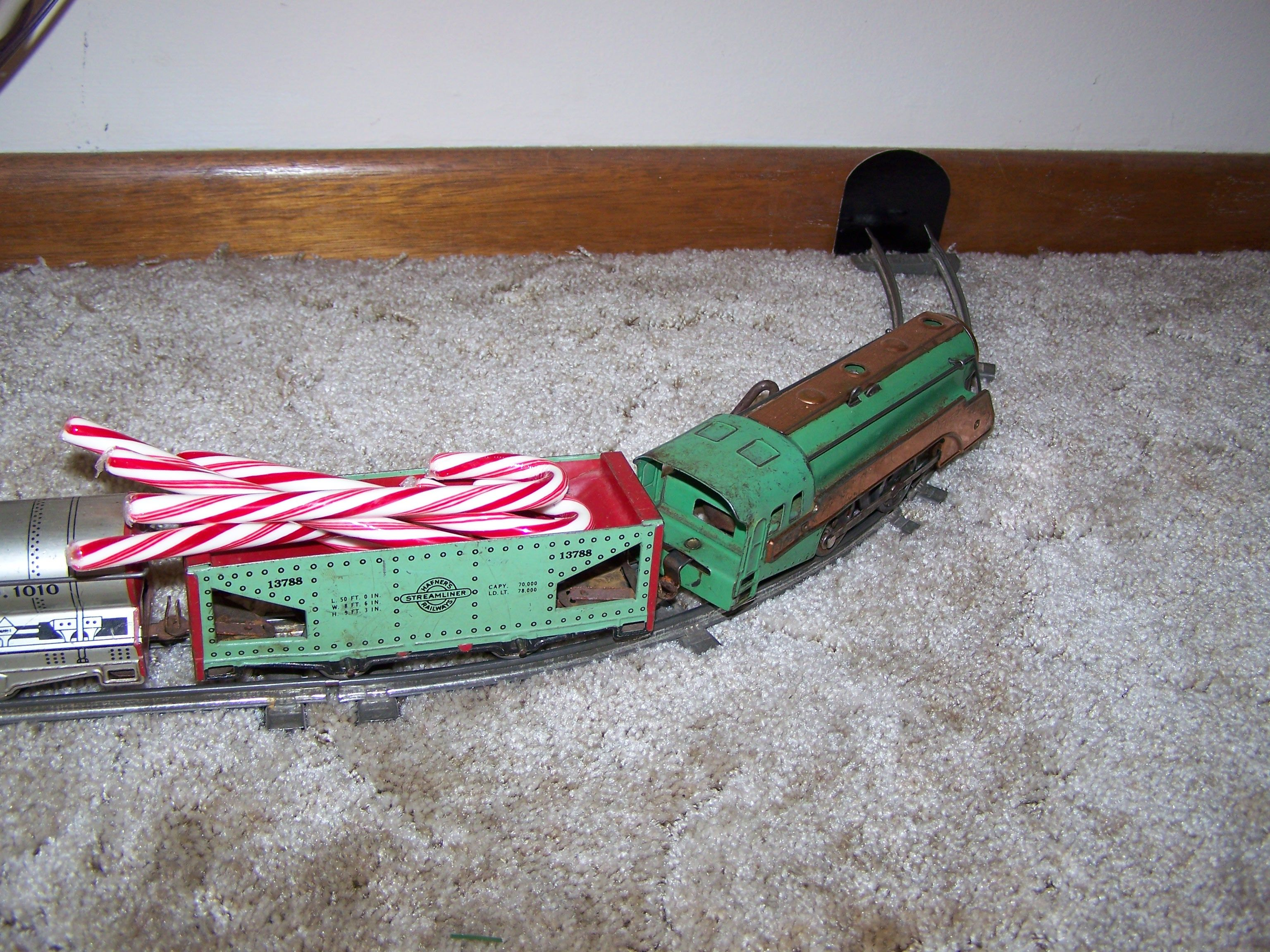 My Mom's neat idea to display the Christmas train without taking up a lot of space. She made the tunnel holes at each end of the semi-circle.