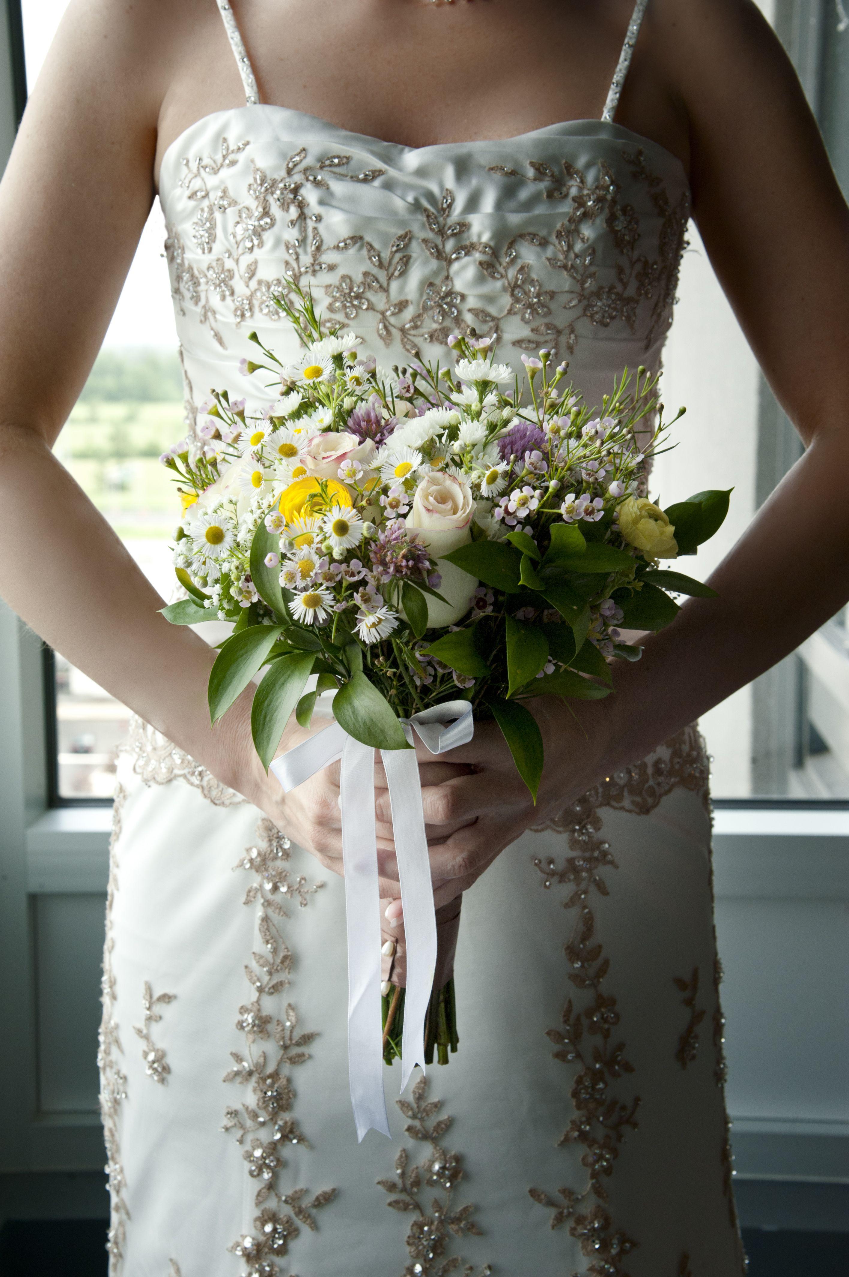 Bridal bouquet roses ranunculus aster wax flower etc