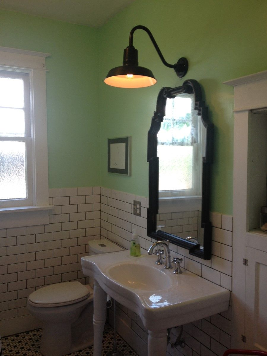 Industrial bathroom light fixture feat black frame mirror and two tones wall ideas types of lighting fixtures for your bathroom