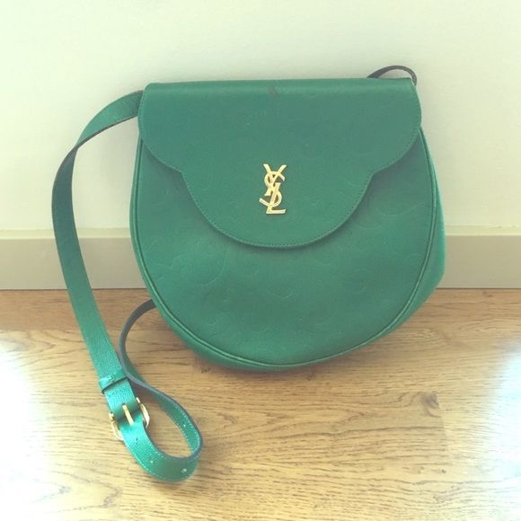 Vintage YSL bag Gorgeous vintage green YSL bag. Can be worn cross body or just on your shoulder. Light wear throughout and black mark on top of the flap (shown in pictures). Yves Saint Laurent Bags Crossbody Bags
