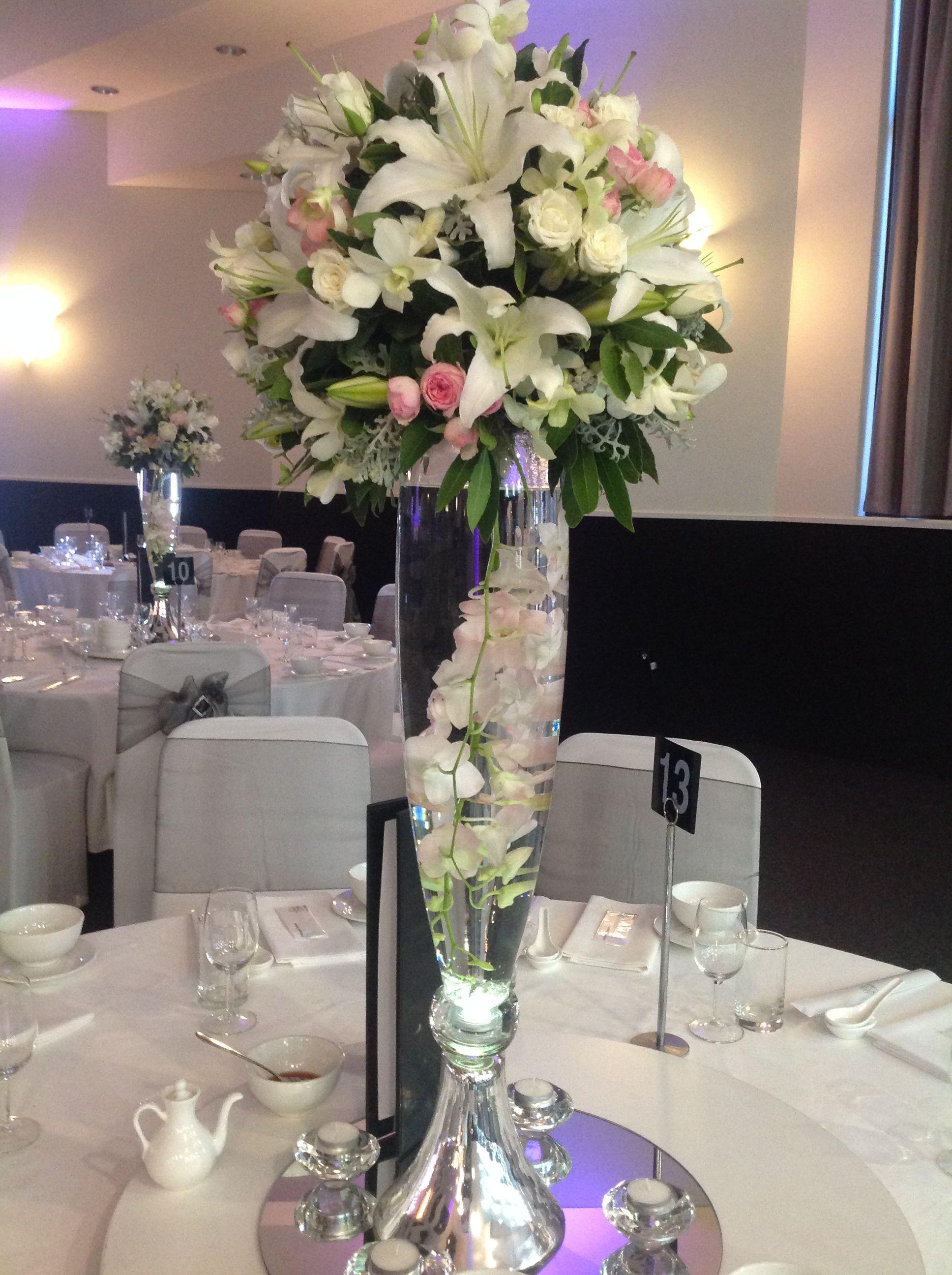 Wedding reception centrepiece made up of Oriental Lillies