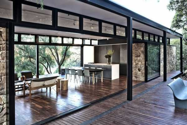 Modern House Design Blending Stone Steel And Wood Into Modernist Box With Glass Walls Modern House Design Steel Frame House Steel House