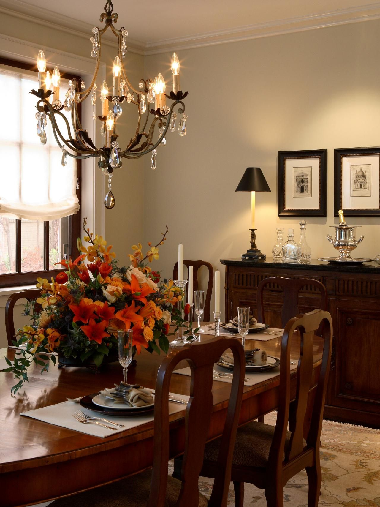 A dazzling chandelier and floral centerpiece inject life and color