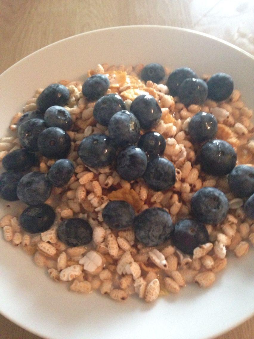 Nearly vegan breakfast for dinner! Puffed rice, cornflakes, almond milk, honey and blueberries