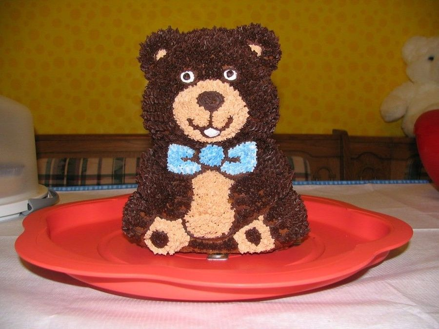 I made this 3D teddy bear for my son's first birthday almost a year ago (my baby's growing up so fast!!!).  It was my first time using decorating bags, tips, the whole sha-bang!  I used the retired 3D bear pan.  Learned a lot, and hope to improve with every cake I do.  Thanks for looking!