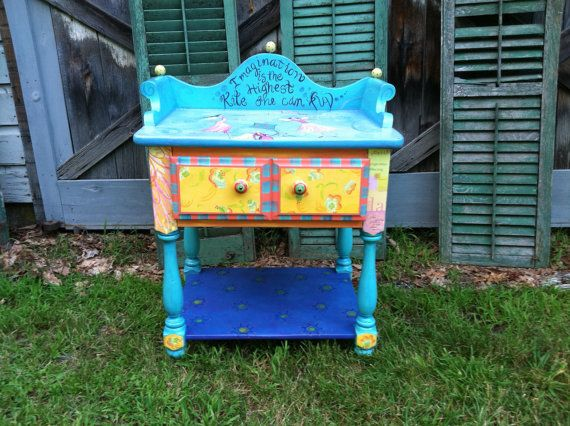 This delightful table would make anybody smile. It was hand painted by me with a touch of decoupage....then clear-coated. It would be perfect in a child's room but really can go anywhere. etsy.com