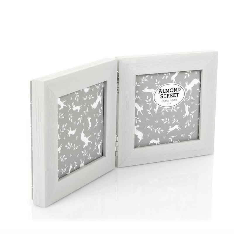 This double photo frame has space for two individual 4 x 4 inch ...