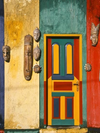 Colorfully Painted Building Decorated with Masks,