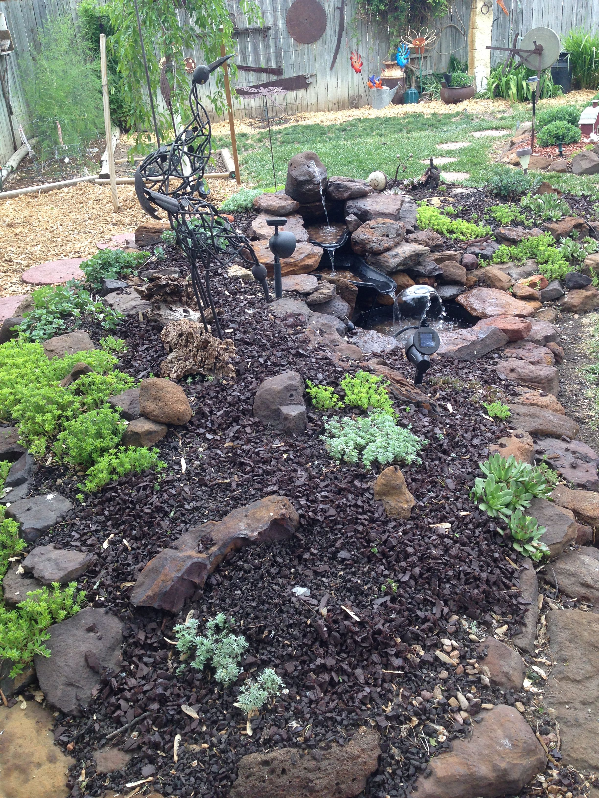 our other backyard berm with waterfeature waterfall pond the