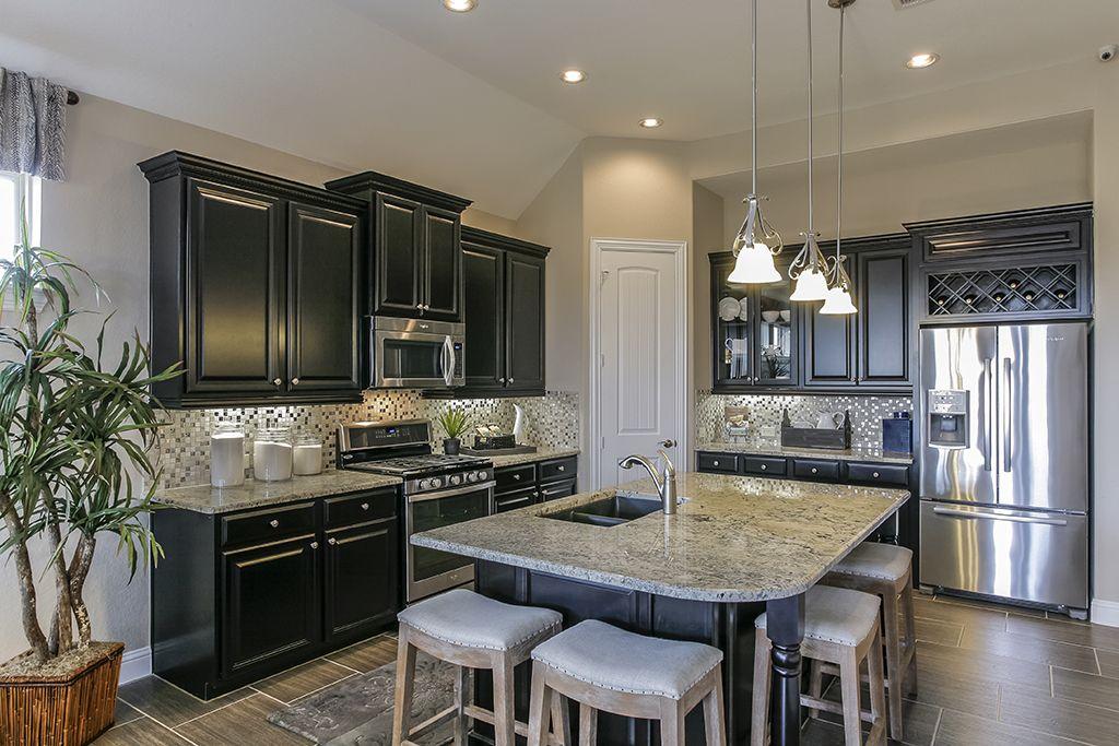 gehan homes kitchen black cabinets stainless steel appliances granite countertops wine rack