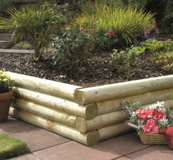 If you don't like the look of traditional sleepers these Grange rounded garden sleepers have a softer look. #GrowYourOwnVeg